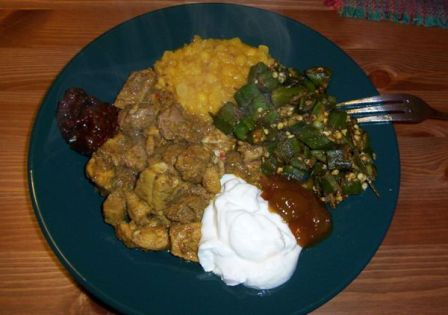 Delectable pork, okra, dal, yogurt and chutney